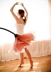 Canada, Quebec, Montreal, Young female Ballerina dancing with Blooming Flower appearing as tutu