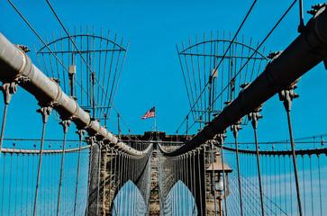 USA, New York State, New York City, Brooklyn Bridge with flag