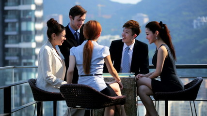 Young Multi Ethnic Share Brokers Tablet Office Rooftop