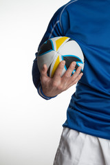 Close up of man holding Rugby ball