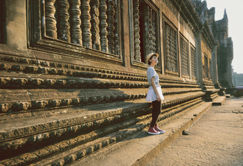 Cambodia, Angkor Wat, Woman standing outside temple
