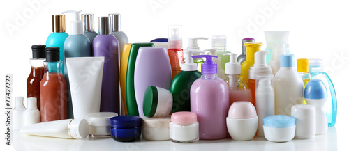 Group of cosmetic bottles isolated on white - 77427222