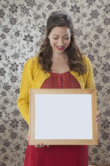 Woman holding empty frame
