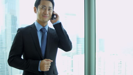 Male Asian Chinese Stock Broker Smart Phone Close Up