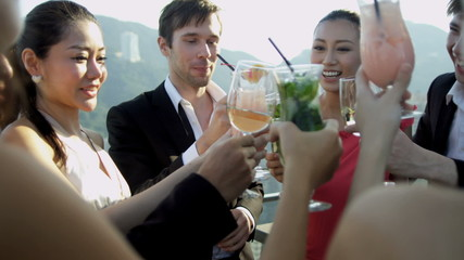 Young Multi Ethnic Share Brokers Celebrating Rooftop Bar