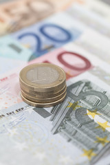 Stack of Euro counts on euro banknotes