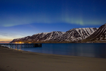 Iceland, Flateyri, Onundarfjordur, Northern lights and sunset