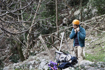 Italy, Lazio, Roccia, Man adjusting helmet before climbing