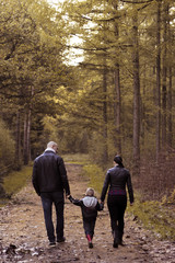 Family walking around in forest