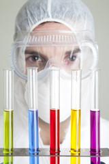 Scientist looking at test tubes in rack