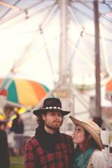 Portrait of couple wearing cowboy hats at fairground