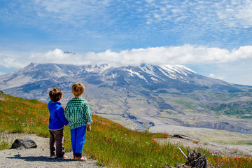 Two boys (2-3, 4-5) looking at view
