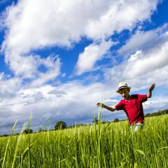 Boy running through field