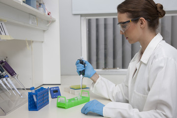 Lab technician using micro-pipette