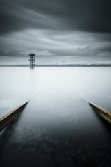 Switzerland, Vaud, Saint-Prex, Lake Leman, Slipway in still lake with storm clouds