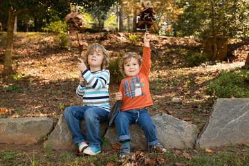 Boys (2-5) having fun in autumn park