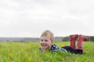 Boy lying in grass