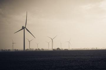 United Kingdom, England, Bedfordshire, Biggleswade, Wind turbines in misty fields