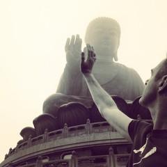 China, Hong Kong, Man with High-Fiving Buddha