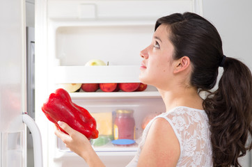 young beautiful woman searching for food in the fridge