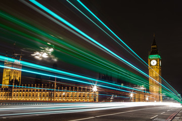 United Kingdom, England, London, Westminster Bridge, Houses of Parliament and Big Ben with light trails in foreground
