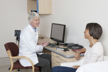 Doctor talking to patient in examination room