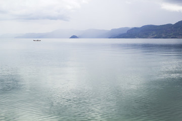 Indonesia, Sumatra, Lake Toba, Lonely boat in lake