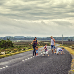 Family dancing on road