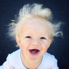 Portrait of toddler (18-23 months) with flyaway hair