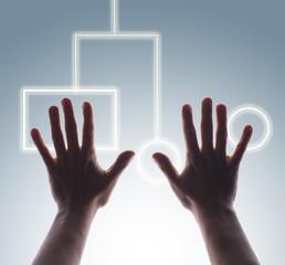 Studio shot of man's hands touching digital touch screen buttons