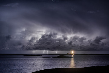 Norway, View of lighthouse in thunderstorm