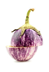 Gourmet purple eggplant cut in half isolated on white