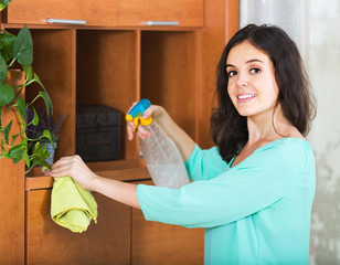woman removes dust