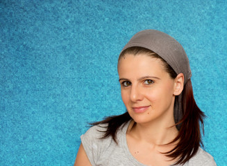 Portrait of woman on blue background