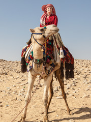 Egypt, Giza, Woman on camel in desert