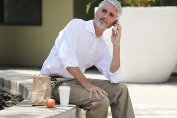 Businessman on lunch break talking on phone