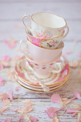 Stack of pink vintage cups