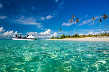 Malaysia, Sabah, Boat moored on beach at island