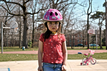 Disappointed child (4-5) in bike helmet