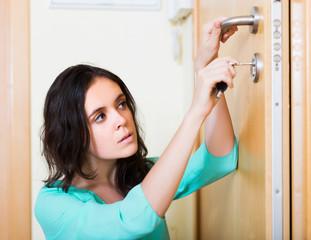 Housewife trying to lock door