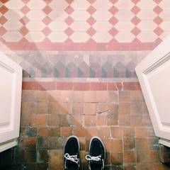 Spain, Barcelona, Canvas shoes on tiled flooring