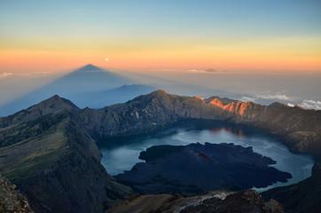 Indonesia, West Nusa Tenggara, View of Mt. Rinjani with Segare Anak Lake on background