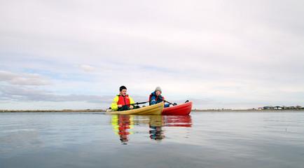 Iceland, Two people in kayaks on lake