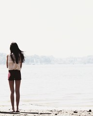 Rear view of girl (12-13) standing on beach