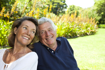 South Africa, Senior couple sitting in the garden