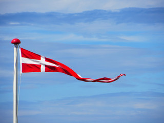 Danish flag against cloudy sky