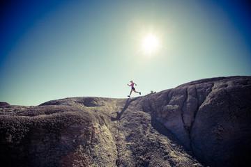 USA, Colorado, Woman running in desert