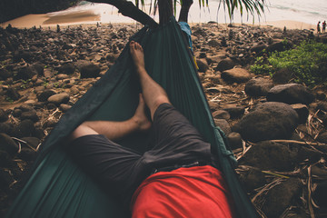 USA, Hawaii Islands, Kauai, Low section of man relaxing on hammock