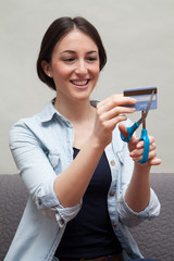 Young Woman Cutting Up Credit Card