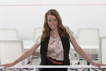 Business woman standing in conference room